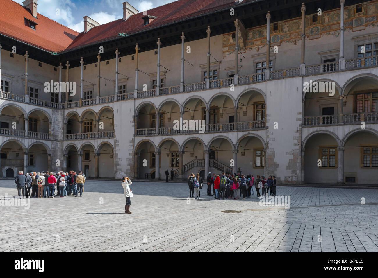 Wawel castle courtyard, the arcaded Renaissance courtyard at the centre of Wawel Royal Castle in Krakow, Poland. - Stock Image