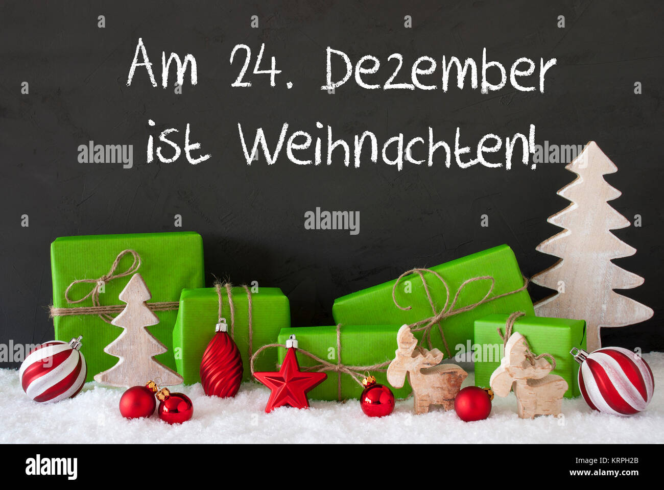 German Text Am 24. Dezember Ist Weihnachten Means December 24th Is Christmas Eve. Green Gifts With Decoration Like - Stock Image