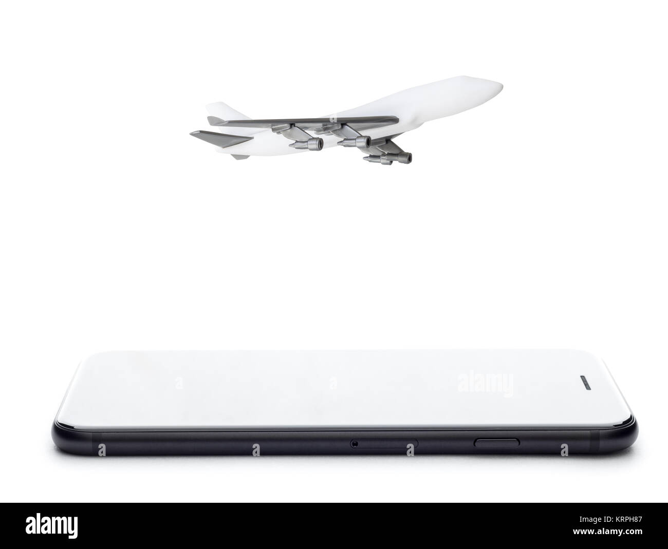 phone and airplane model on white background - Stock Image