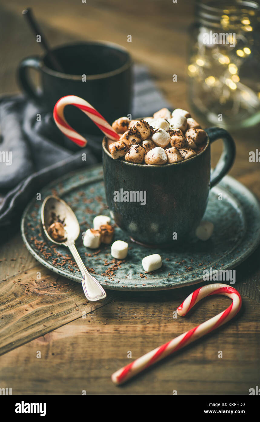 Christmas hot chocolate with marshmallows and cocoa on wooden background - Stock Image