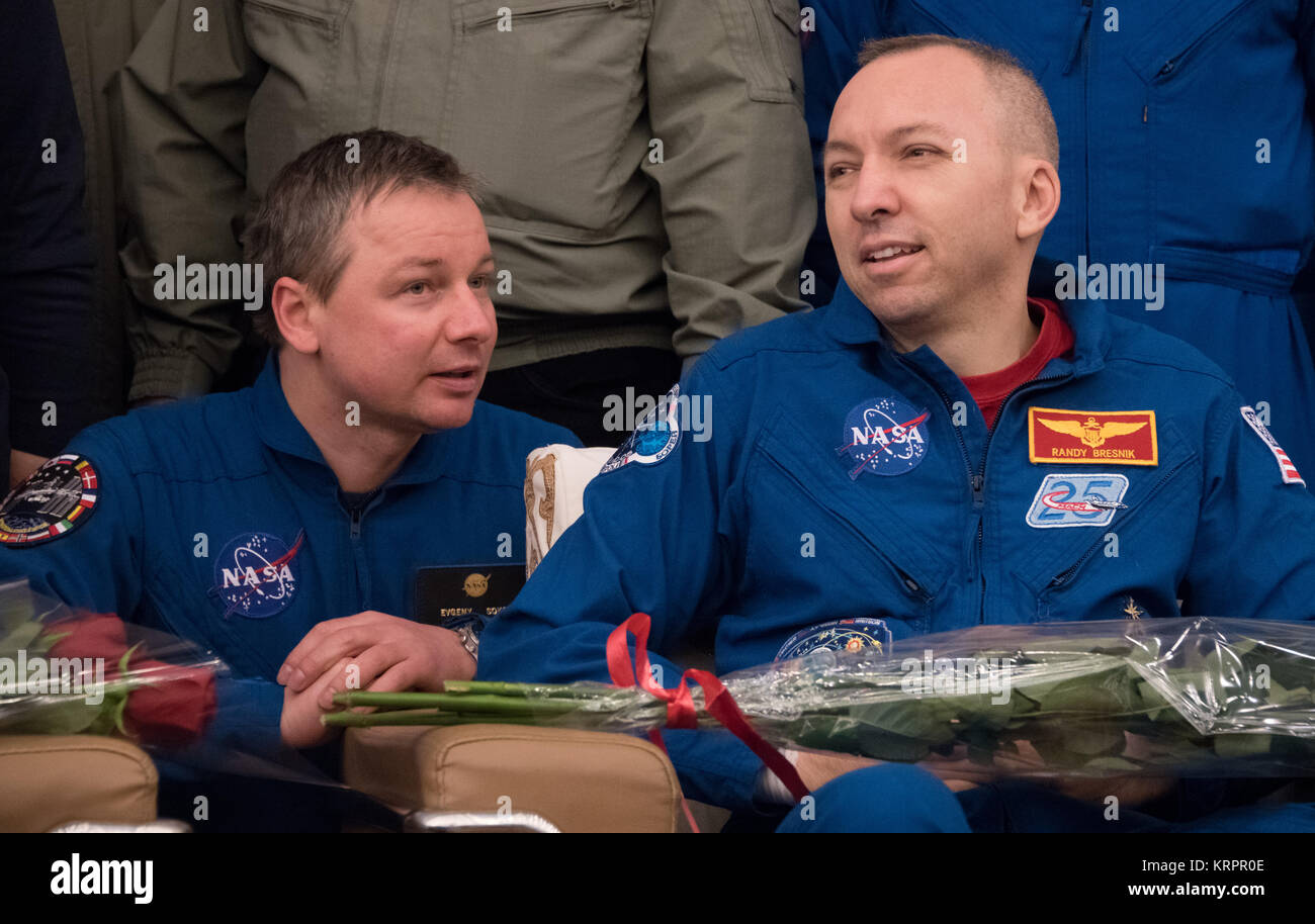 NASA Interpreter Evgeny Sokol (left) interprets NASA International Space Station Expedition 53 prime crew member - Stock Image