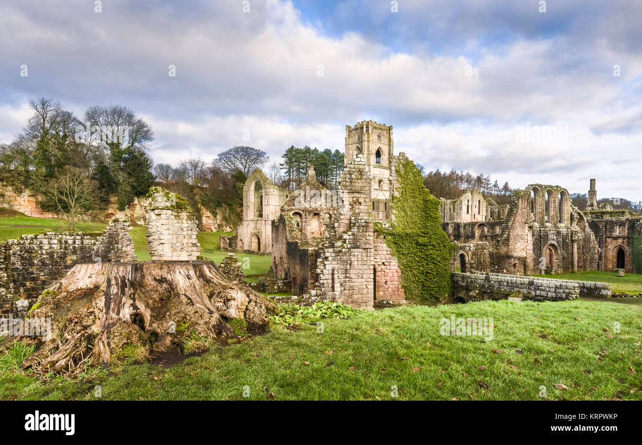 RIPON, UK - DECEMBER 03, 2017:. The ruins of Fountains Abbey on a fine autumn morning as viewed from across the - Stock Image