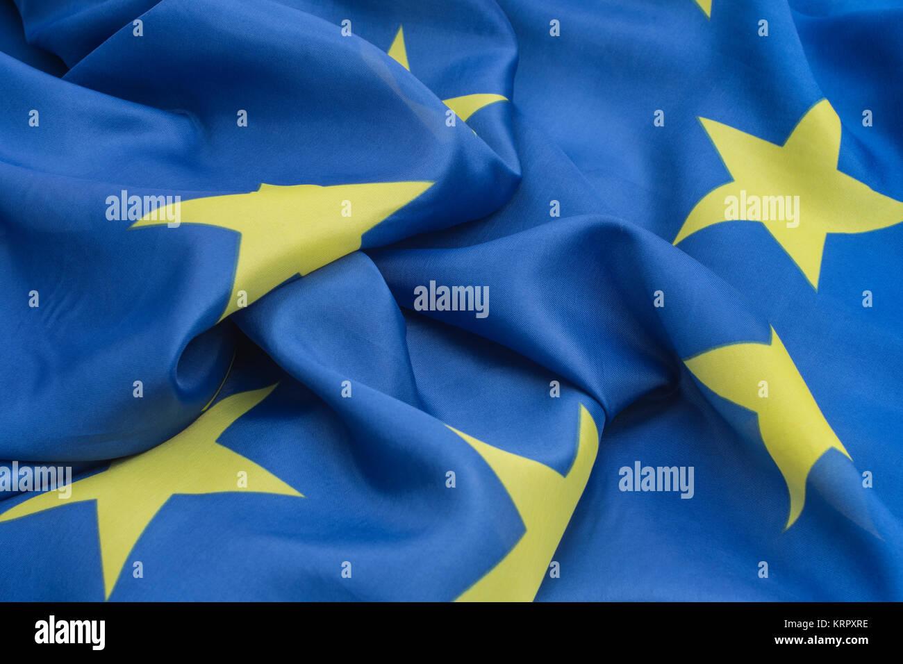 Large, ruffled EU flag - metaphor for EU disunity or discord. - Stock Image