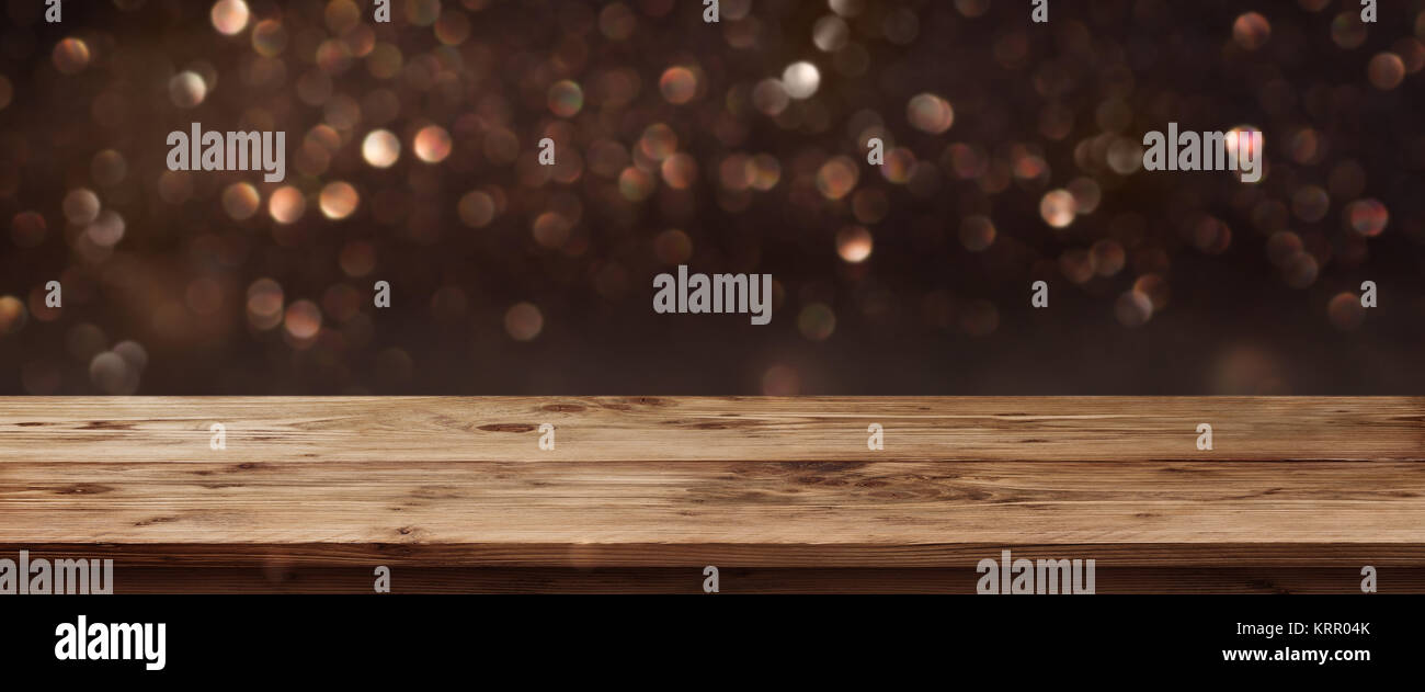 Gold shimmering panorama for public holidays in front of a wooden table and a concept Stock Photo