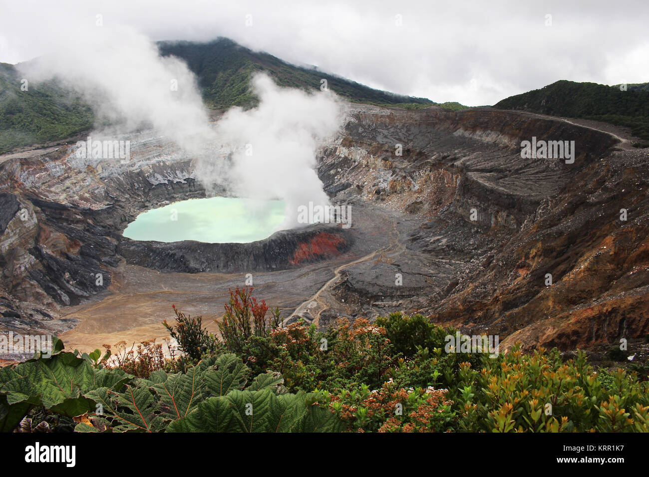 A hot sulfuric acid lake sits in the crater of Costa Rica's Poas Volcano. - Stock Image