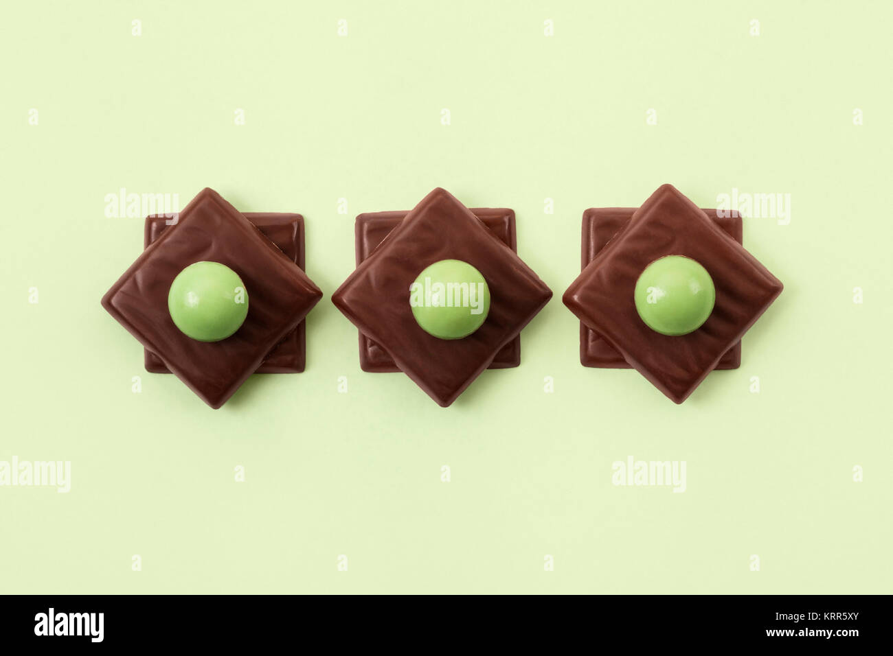 Mint Chocolates arranged in a line - Stock Image