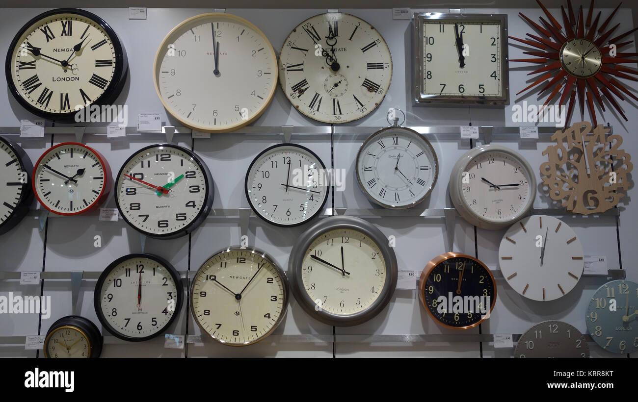 Clocks on sale in John Lewis store - Stock Image
