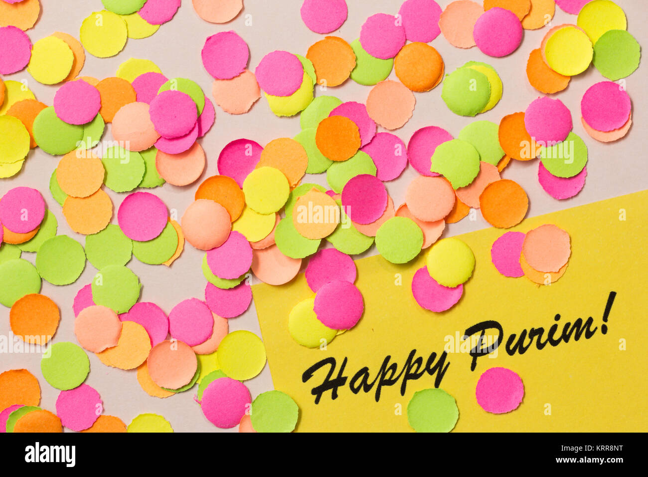 Purim celebration, Jewish tradition. Carnival party background concept, space for text. Colorful confetti spread - Stock Image