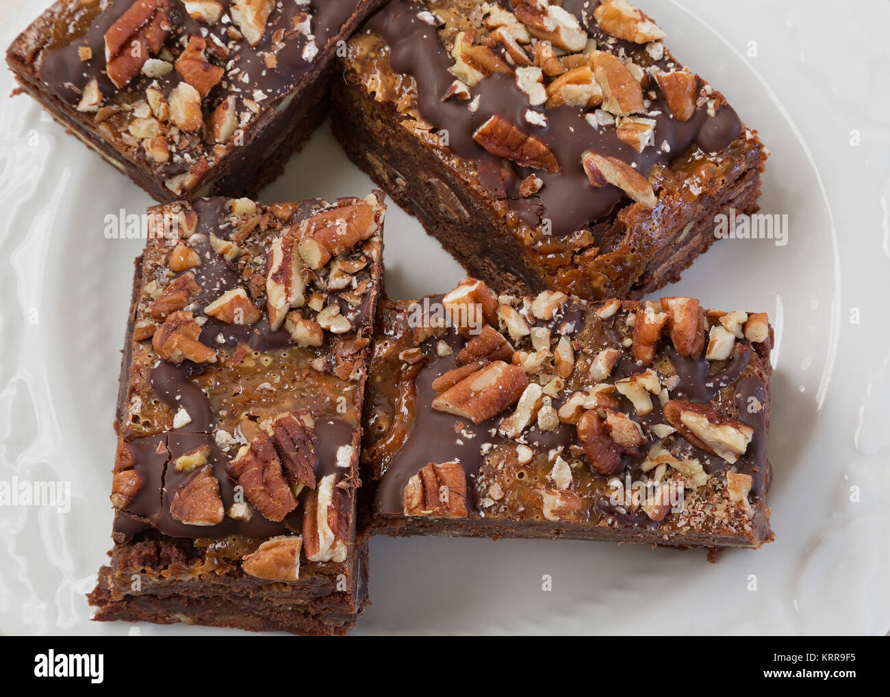 Chocolate brownies with peacans and caramel. Stock Photo