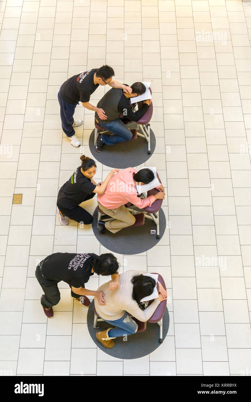 Shoppers receives massages at the Queens Center Mall in the borough of Queens in New York on Sunday, December 17, - Stock Image