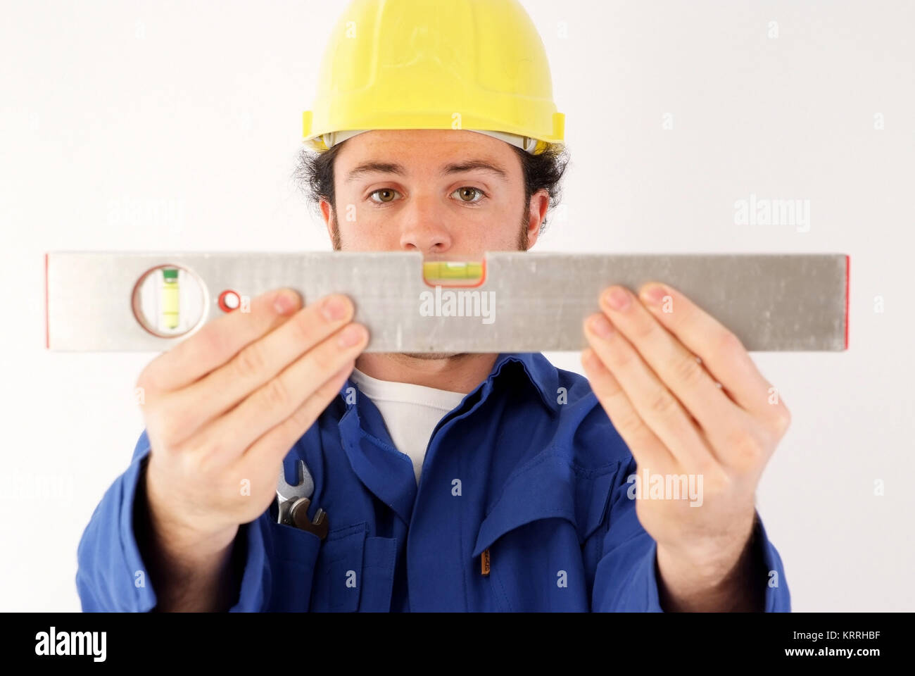 Bauarbeiter mit Wasserwaage - building worker with water scale - Stock Image