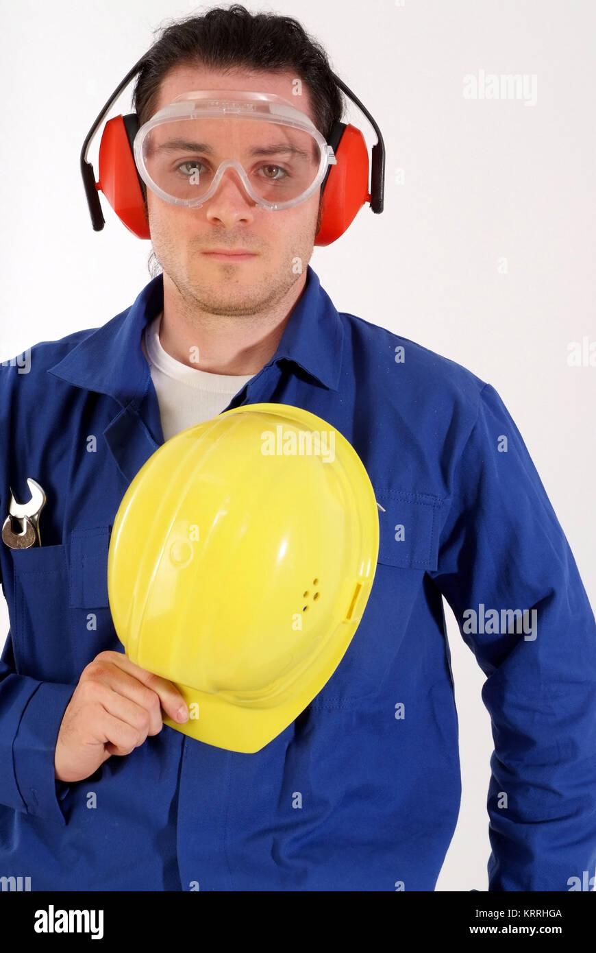 Bauarbeiter mit Gehoerschutz und Schutzbrille - building worker with ear protection - Stock Image