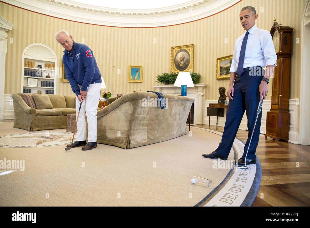 Actor Bill Murray and U.S. President Barack Obama play putt putt golf in the White House Oval Office October 21, - Stock Image