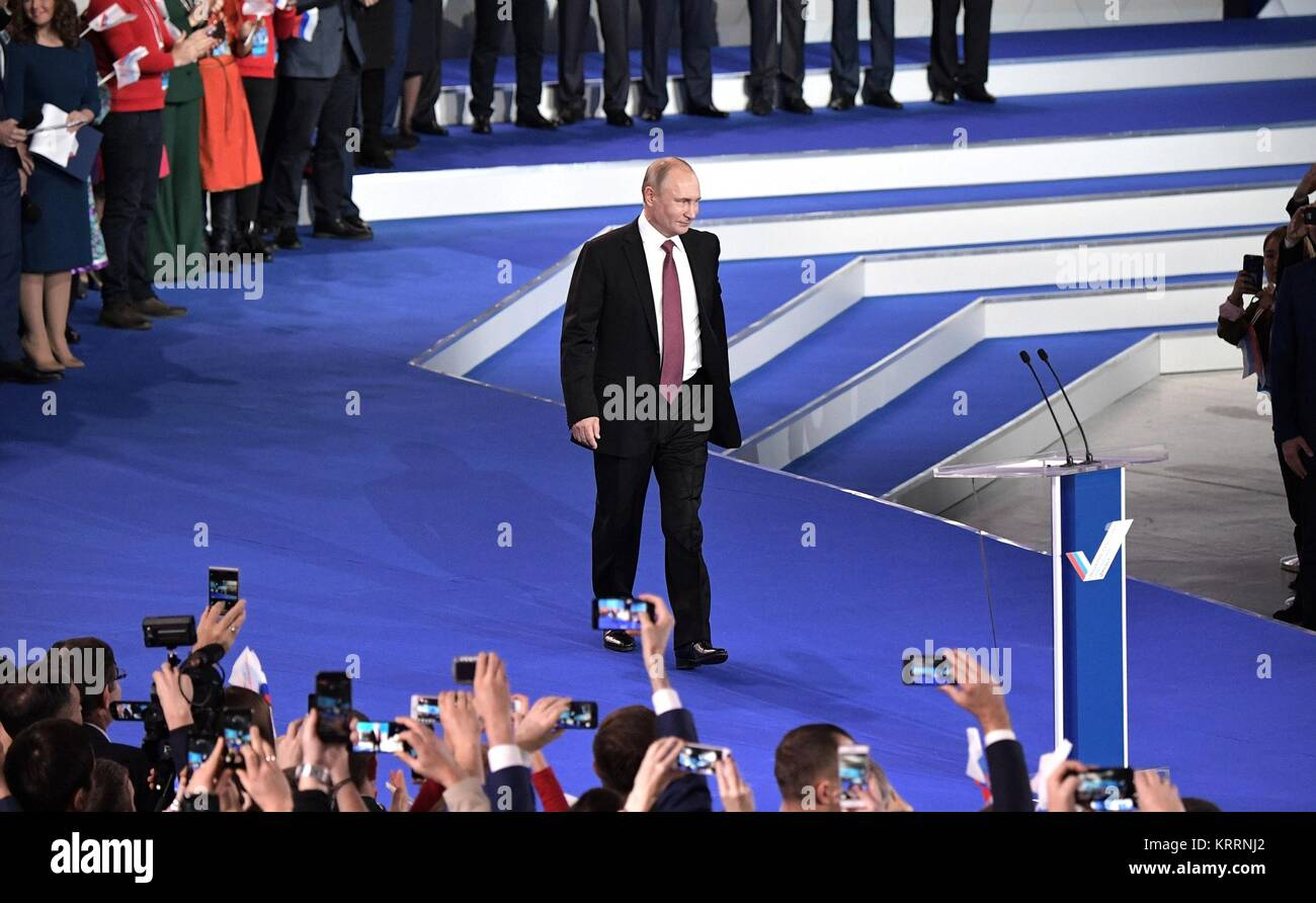 Russian President Vladimir Putin walks on to stage to address the All-Russia People's Front movement kicking off Stock Photo
