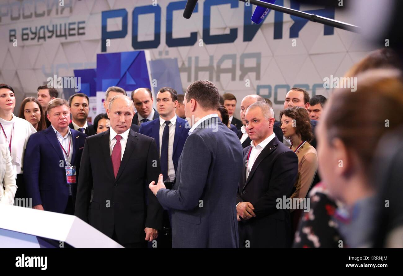 Russian President Vladimir Putin tours an exhibition on the Future of Russia before addressing supporters at the - Stock Image