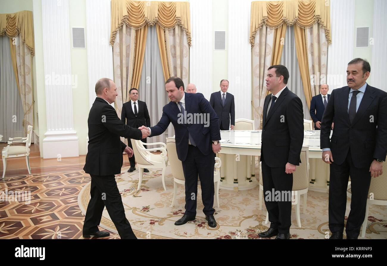 Russian President Vladimir Putin welcomes heads of the Commonwealth of Independent States security services before - Stock Image