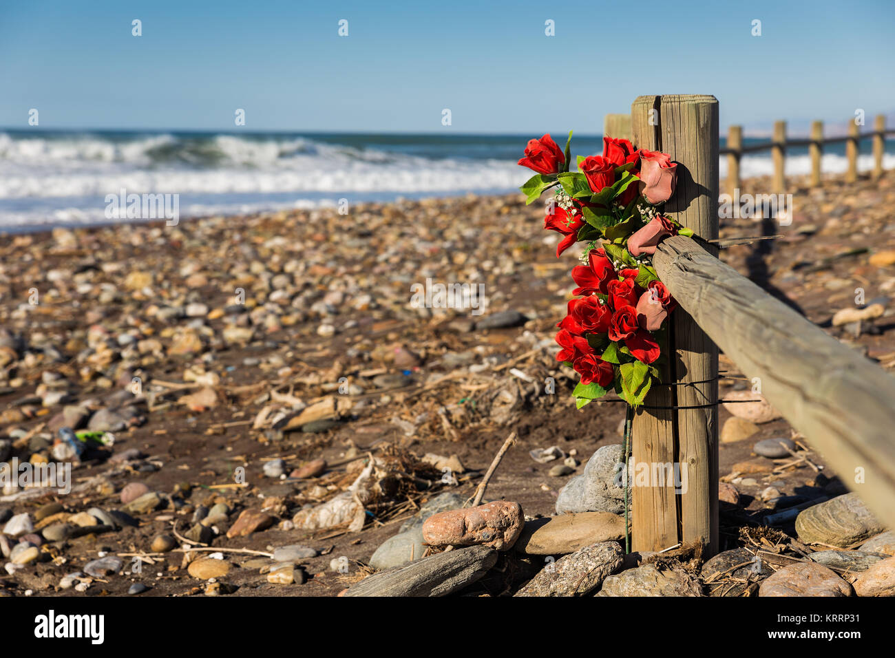 Bouquet of artificial flowers near the seashore. - Stock Image