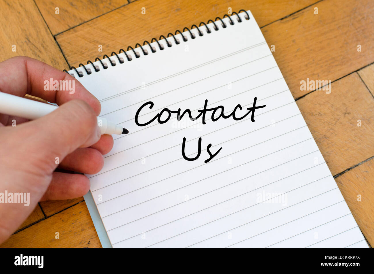 Contact us concept on notebook - Stock Image