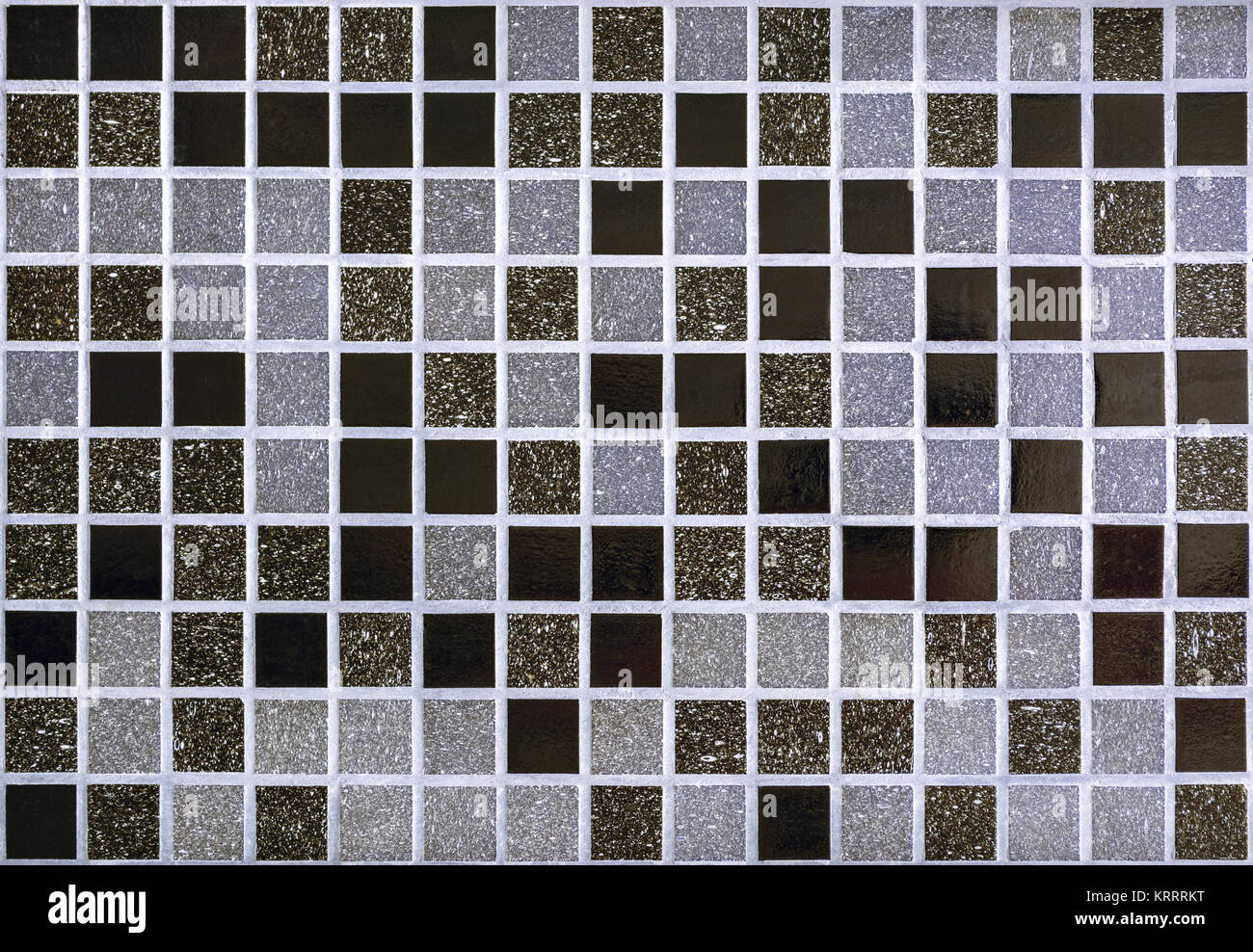 Part of the wall, lined with small mosaic tiles for use as a seamless backgrounds. Stock Photo
