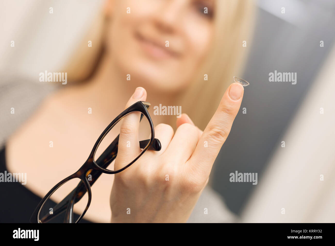 eye care - choice between glasses and contacts - Stock Image