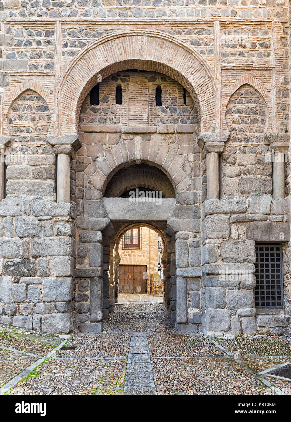 This gate, also known as  Puerta Vieja de Bisagra, was once the main entrance to the city of Toledo. In it the Christian - Stock Image