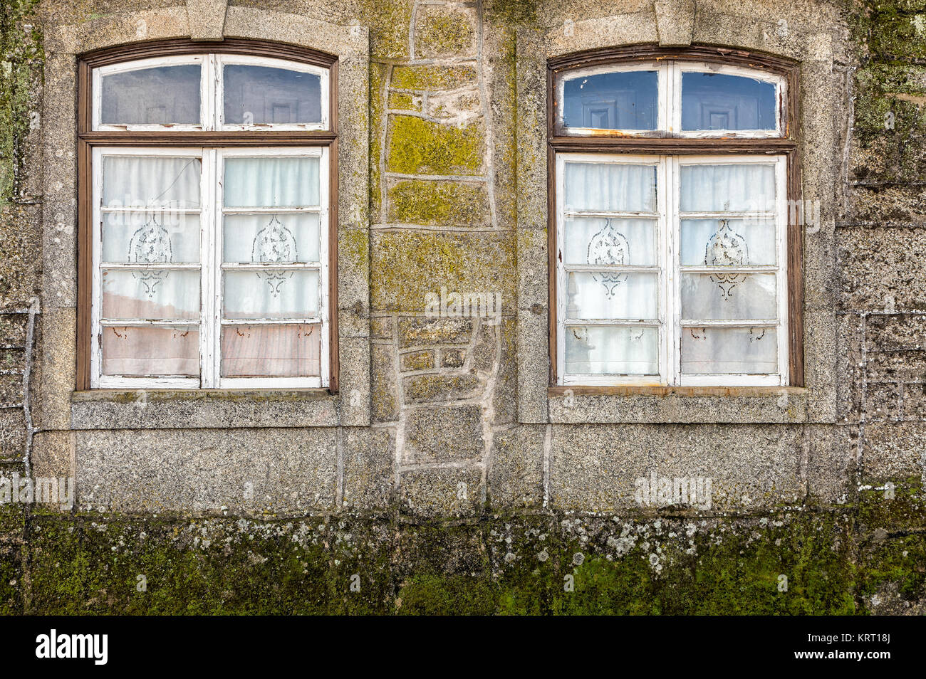 Two old windows in a small town in Portugal. - Stock Image