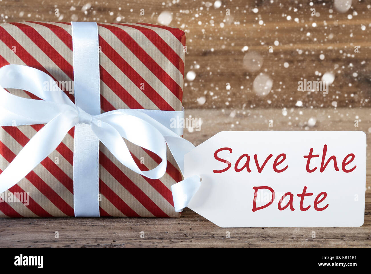 English Text Save The Date. Christmas Gift Or Present On Wooden ...