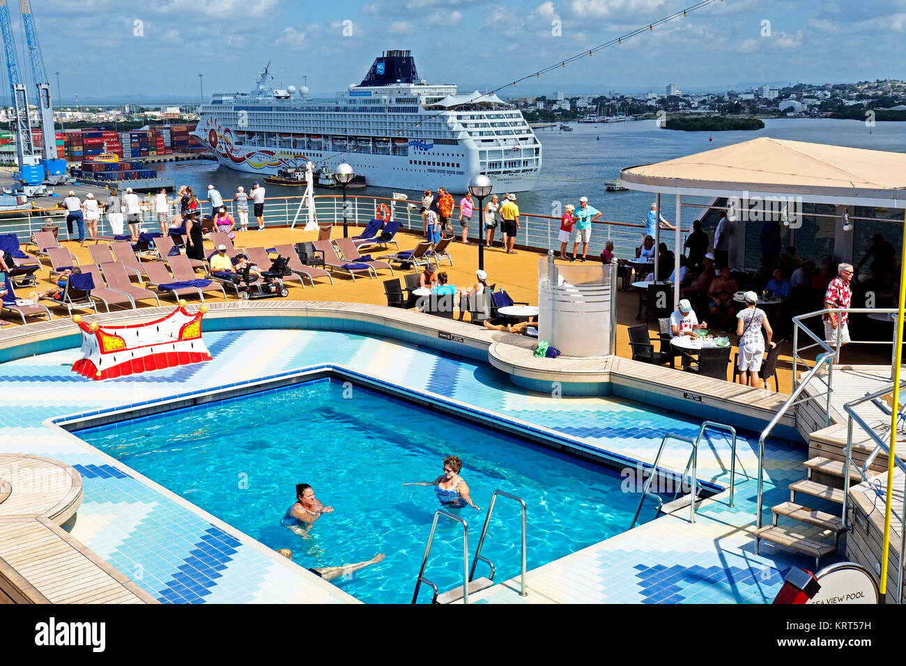 Rear pool deck of Holland America Line's Zuiderdam cruise ship with Norwegian Sun in background at port of Cartagena, - Stock Image