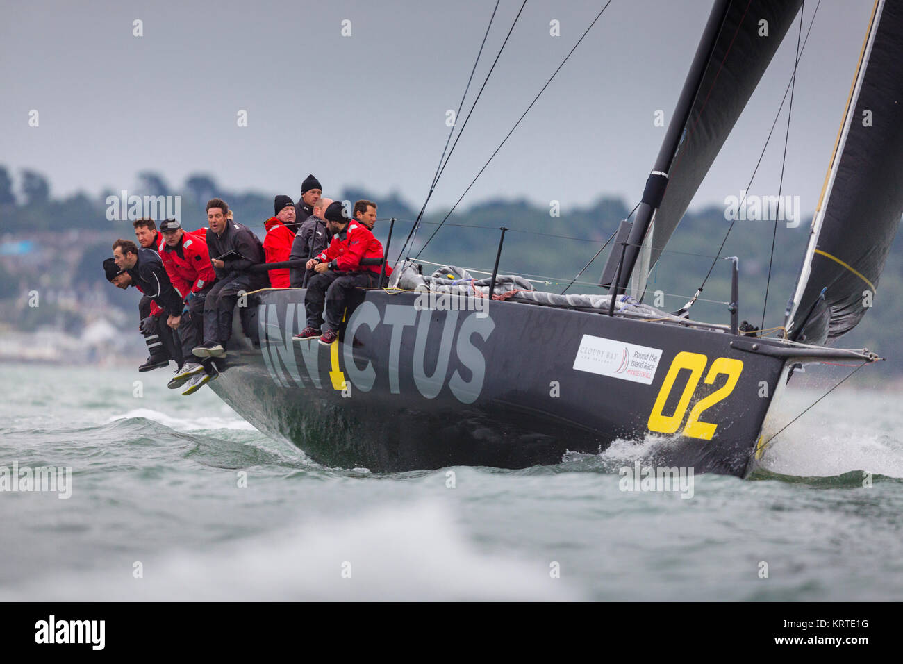 Sir Keith Mills (fourth from the right) on board his racing yacht Invictus as they take part in the annual Round - Stock Image