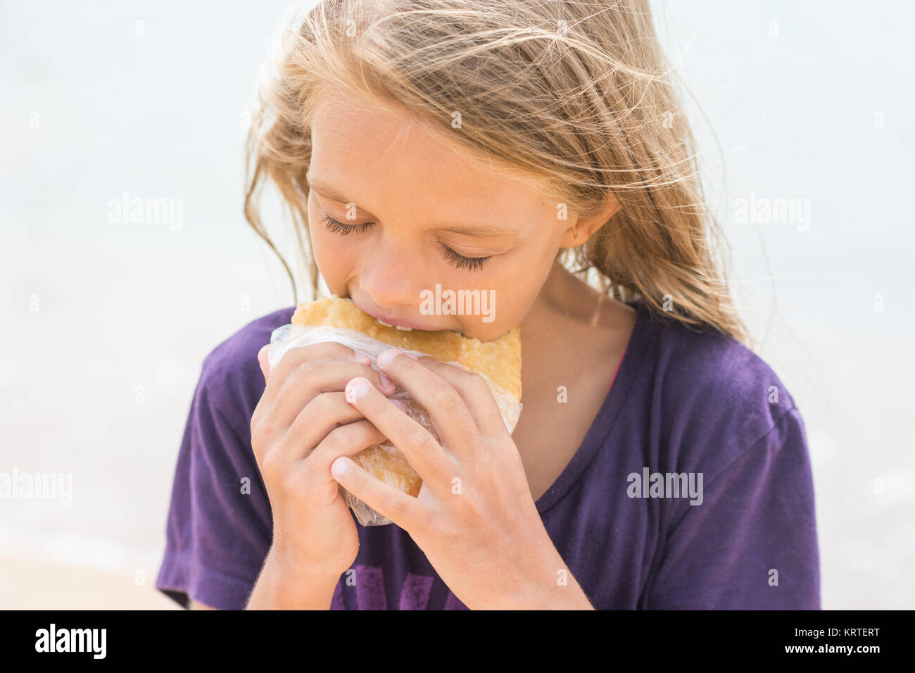 A hungry girl with an appetite for eating pie Stock Photo