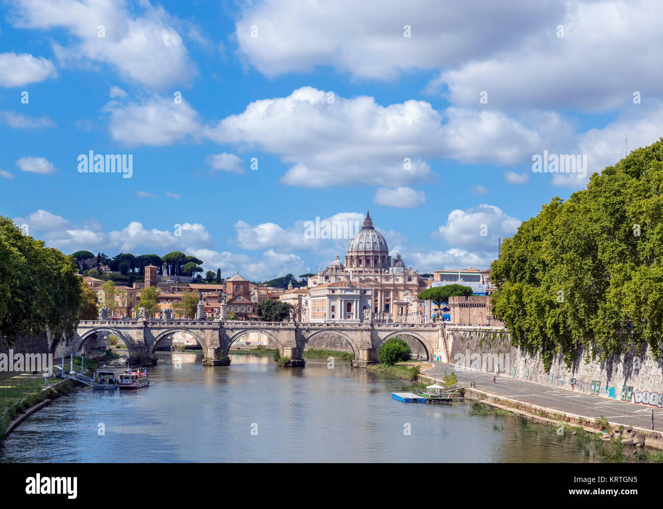 St Peter's Basilica and the Ponte Sant'Angelo over the River Tiber, Rome, Italy - Stock Image