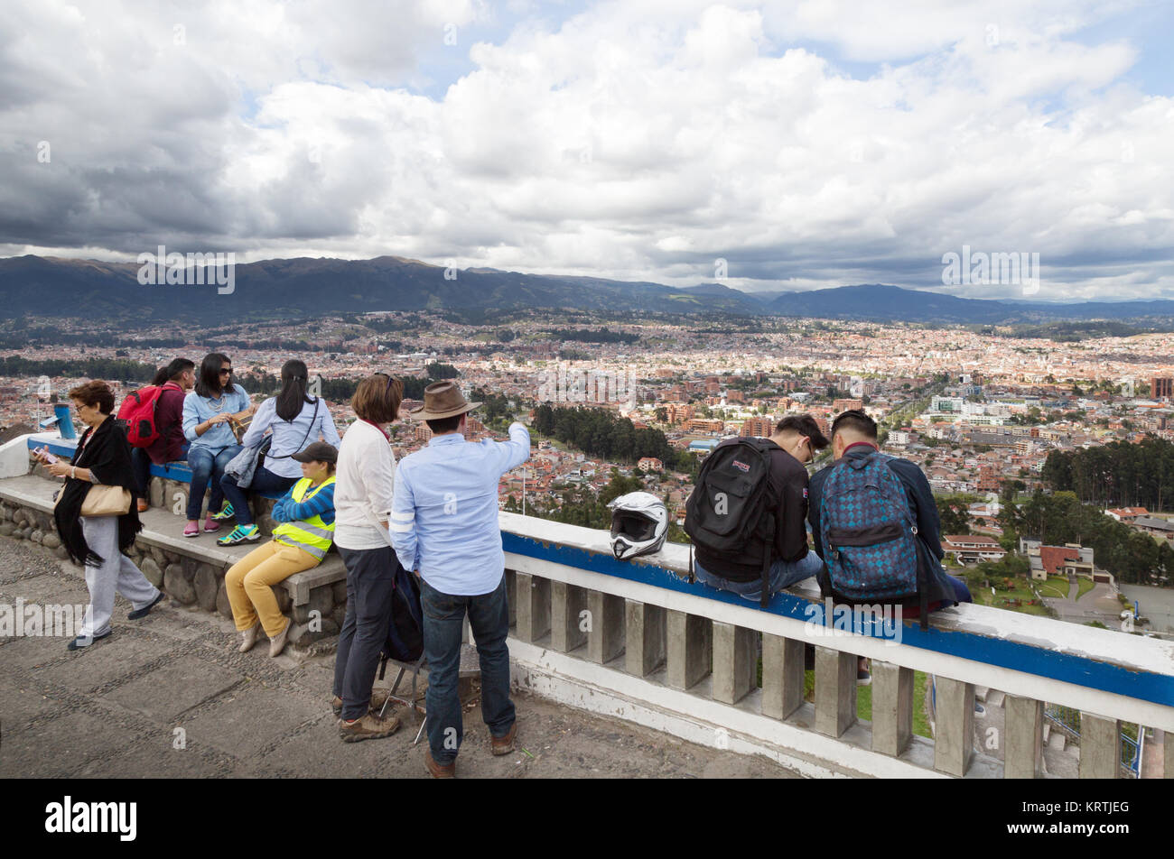 Cuenca Ecuador tourism; a tourist looking out over the city of Cuenca from Turi, Cuenca, Ecuador South America - Stock Image