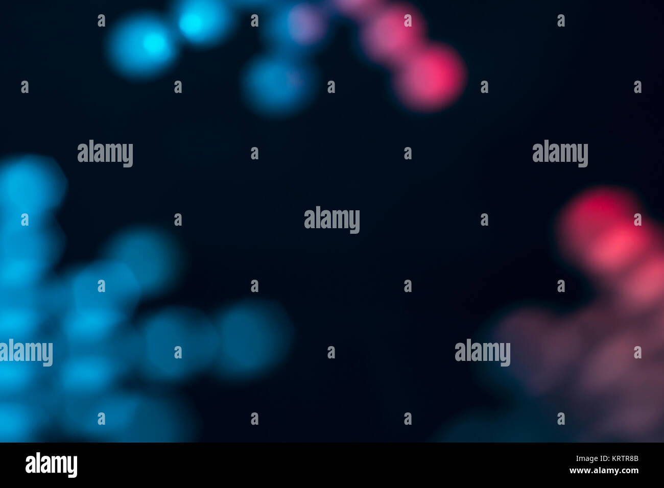 Blue and pink-red abstract shapes suggesting viruses or bacteria. - Stock Image