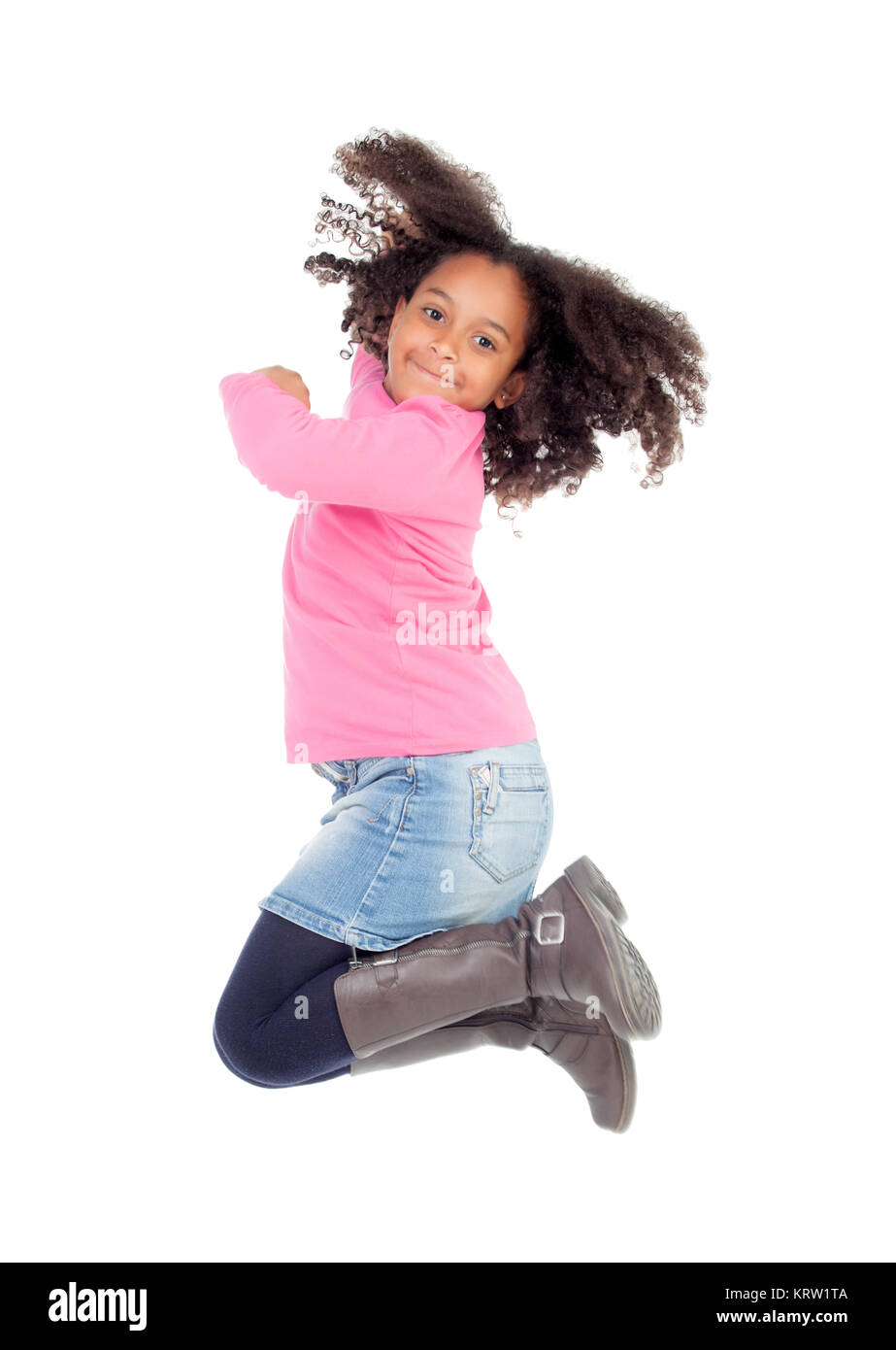 Adorable african little girl jumping - Stock Image