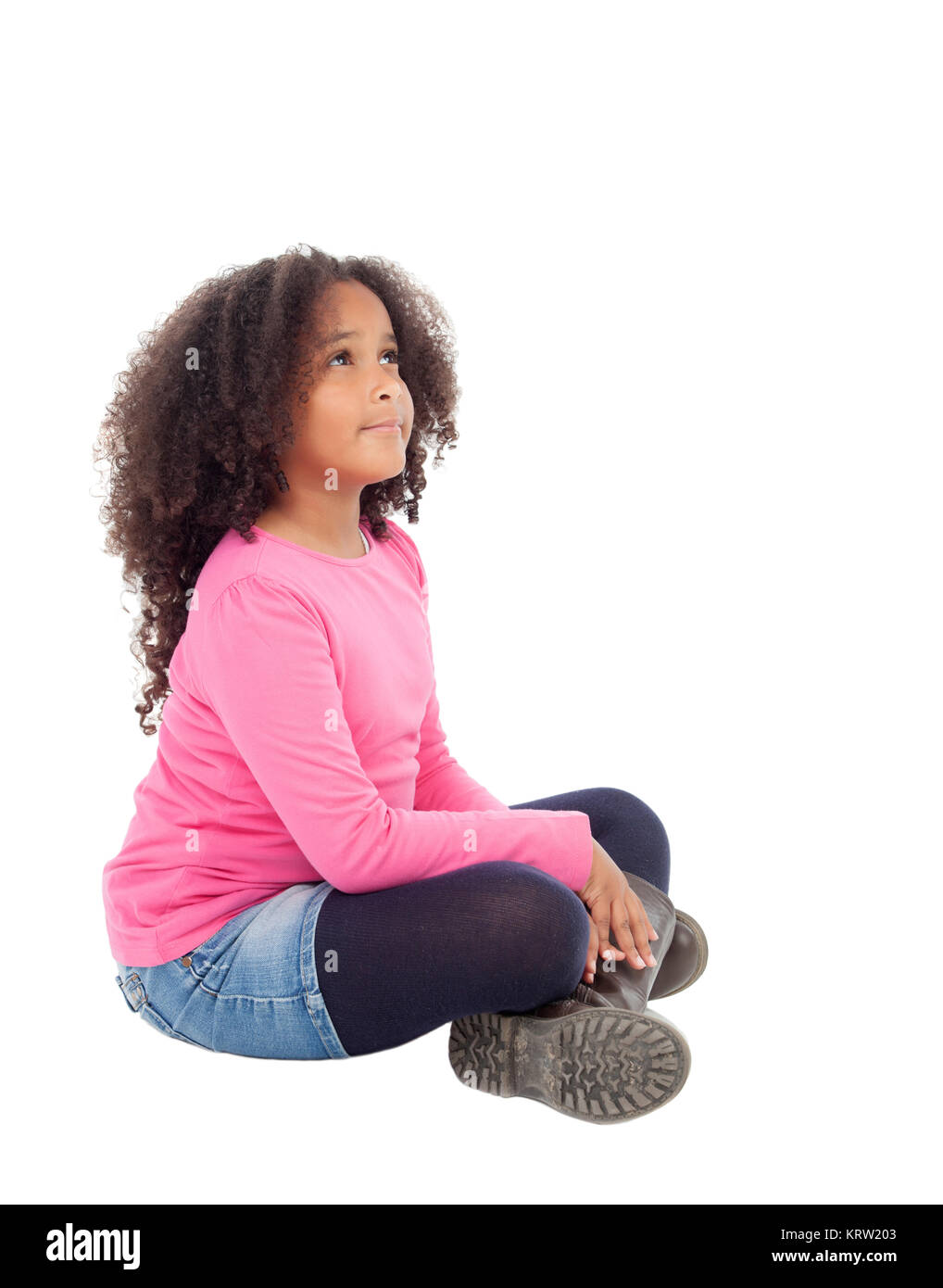 Adorable african little girl sitting on the floor - Stock Image