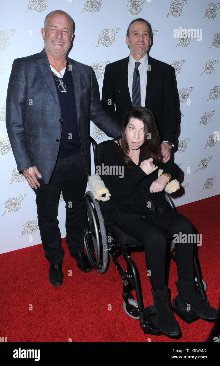 BEVERLY HILLS, CA - FEBRUARY 24: (L-R) Publicist Larry Winokur, publicist/honoree Nanci Ryder and publicist Paul - Stock Image