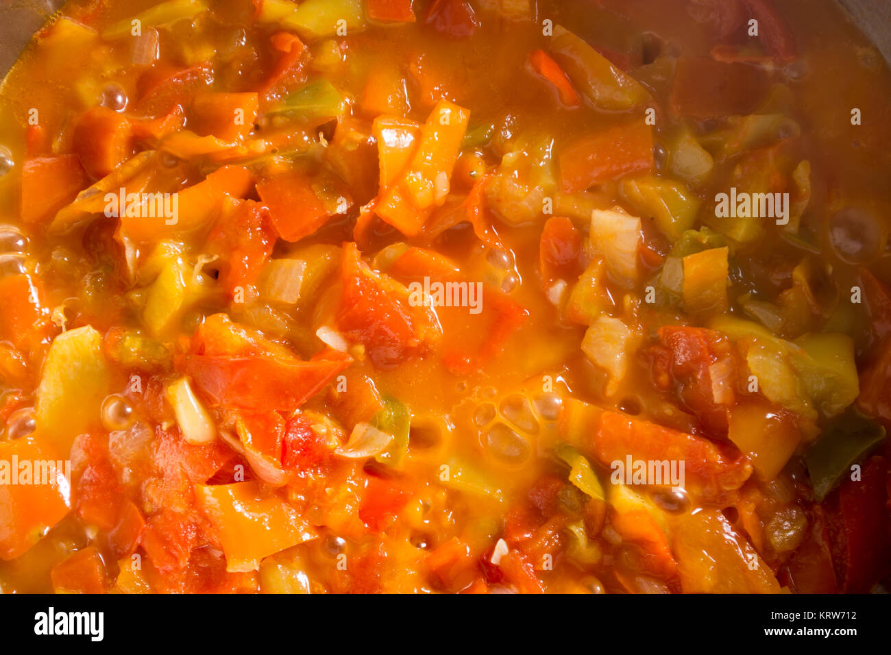 Cooking stew with mixed and colorfull vegetables - Stock Image