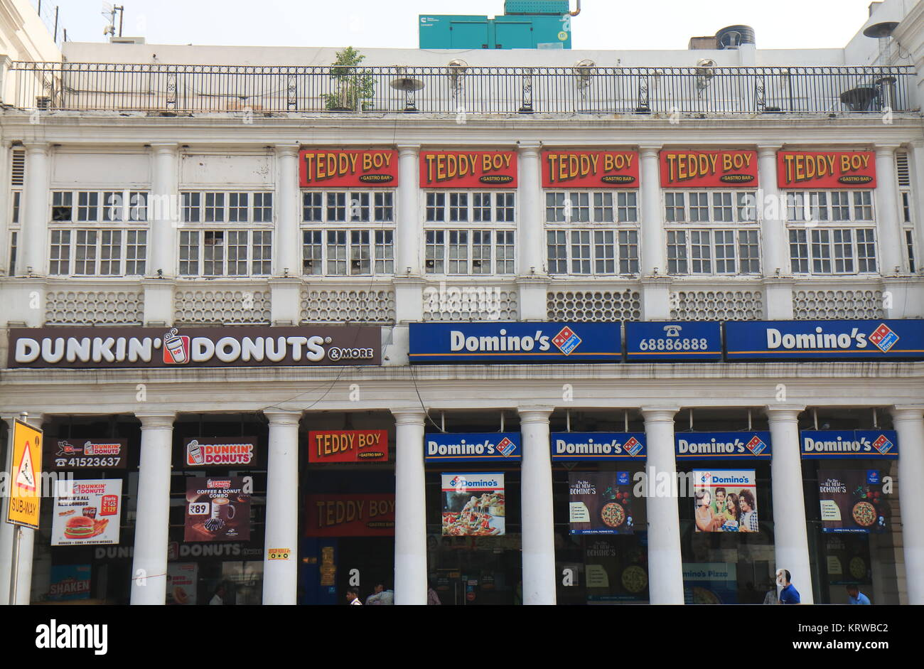 Fast food delivery restaurants in downtown New Delhi India - Stock Image