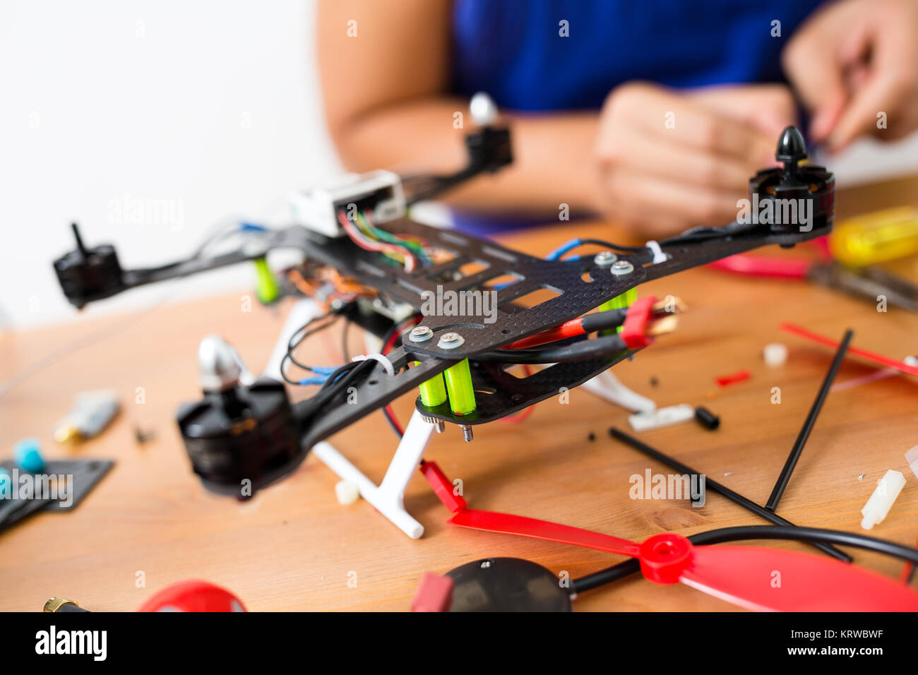 Connecting the electronic parts on drone - Stock Image
