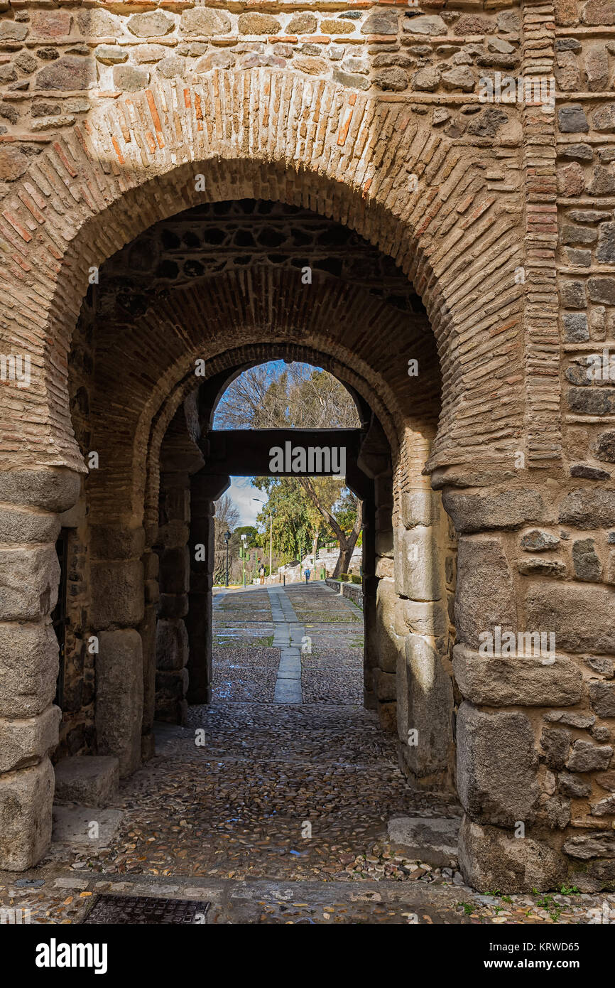 Old gate in the medieval walls of Toledo. Spain. - Stock Image