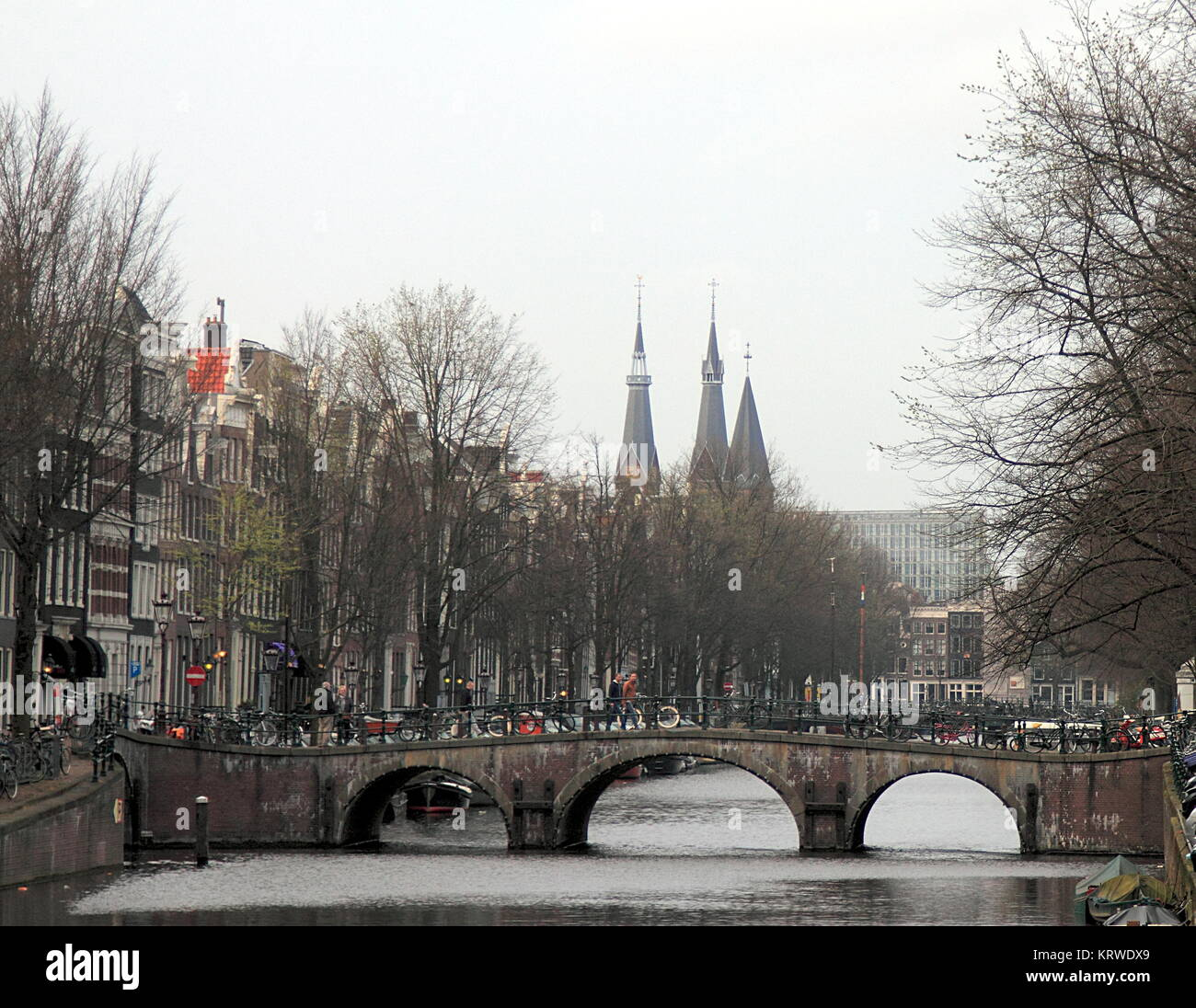 Bridges and buildings of canal ring, Amsterdam, Netherlands, at early spring. - Stock Image