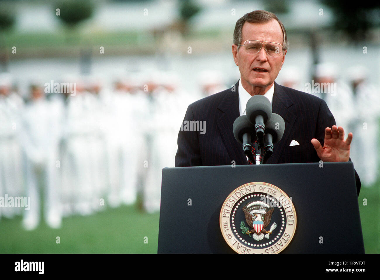 President George H.W. Bush speaks during the retirement ceremony for Admiral William J. Crowe Jr., chairman, Joint - Stock Image