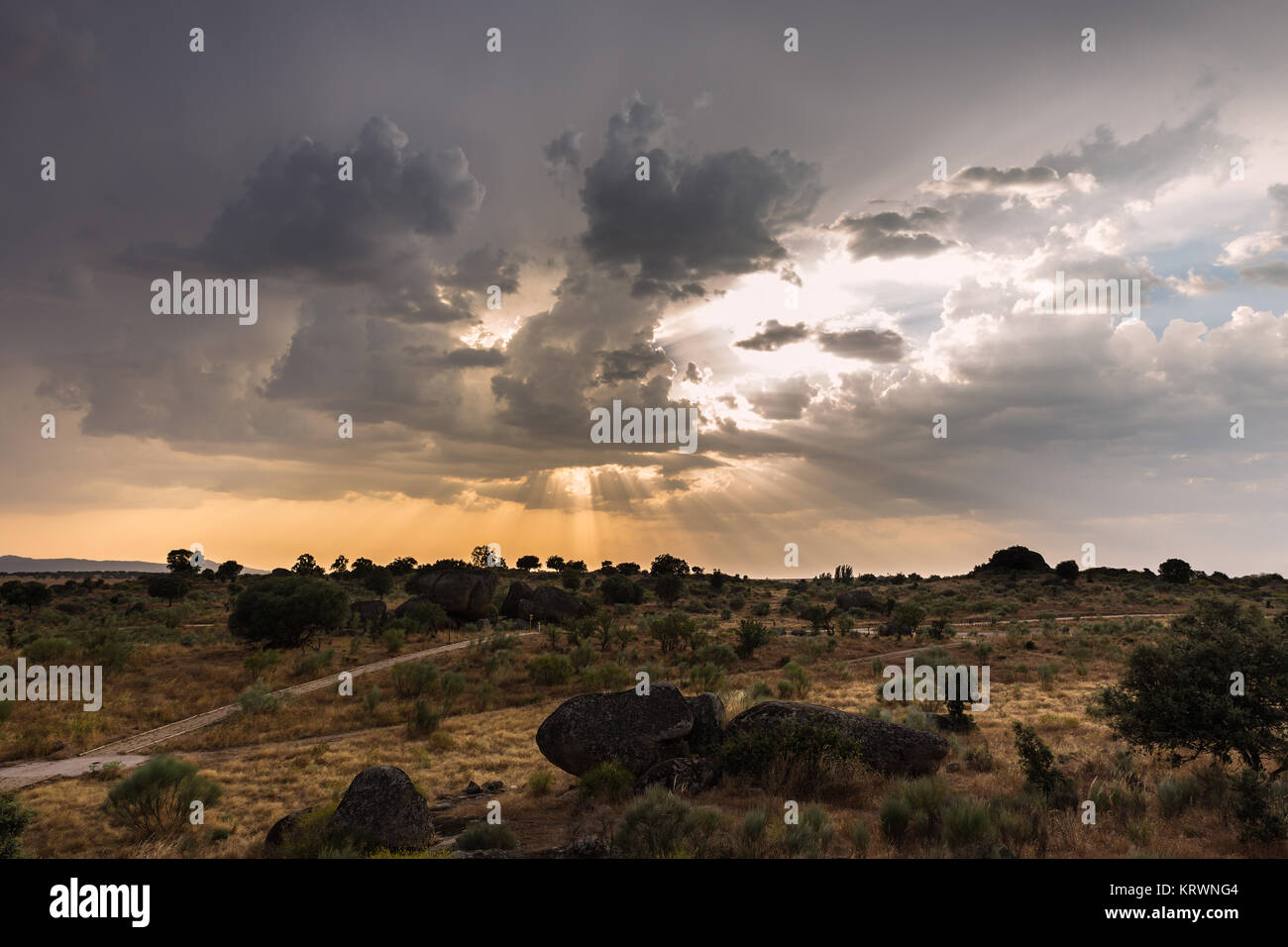 Landscape at sunset with sun rays in the natural area of the Barruecos. Extremadura. Spain. Stock Photo