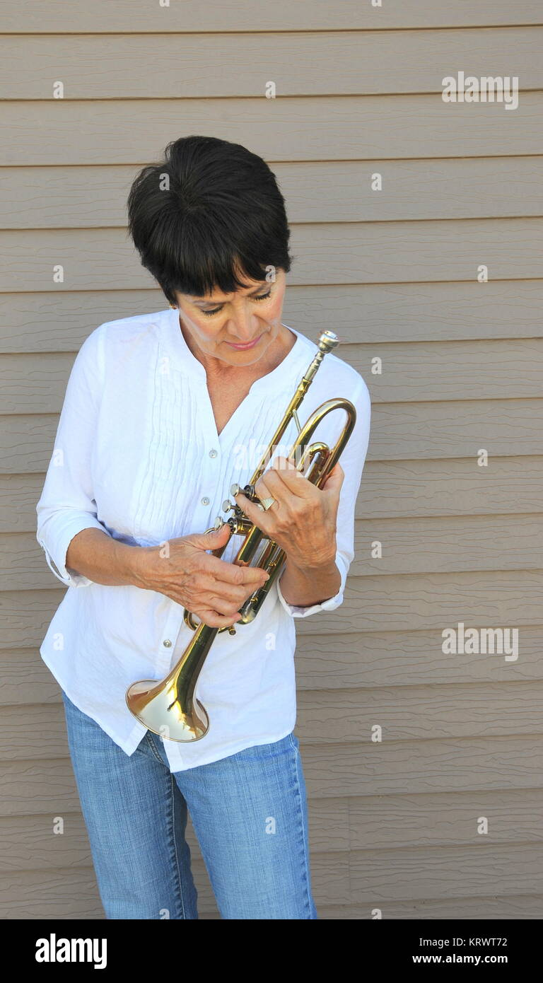 Female trumpet player. - Stock Image