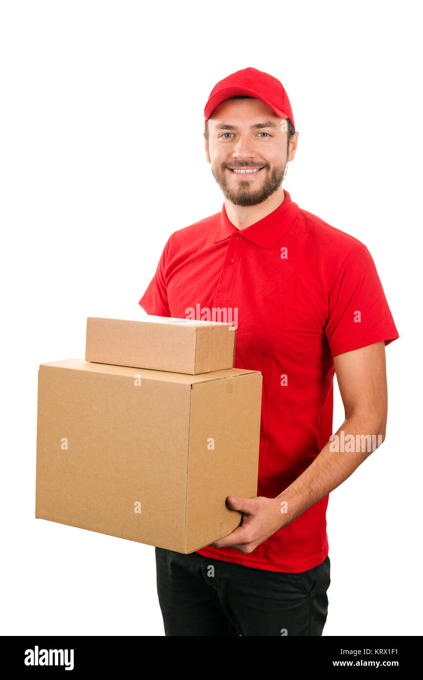 delivery service - young courier holding cardboard box - Stock Image