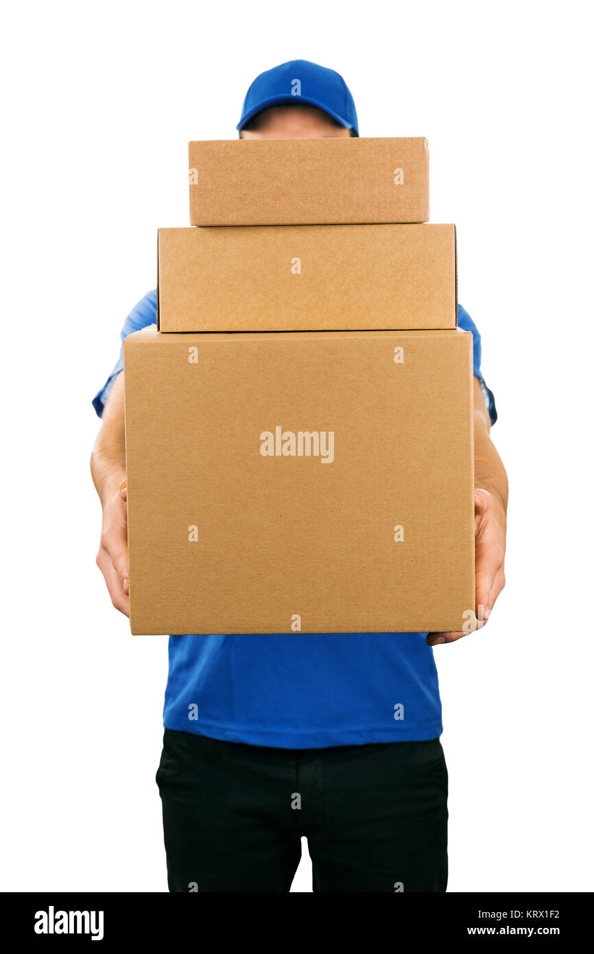delivery man holding pile of cardboard boxes in front - Stock Image
