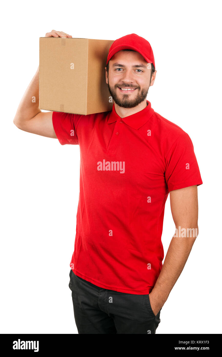 delivery man holding shipping box on the shoulder. isolated on white - Stock Image