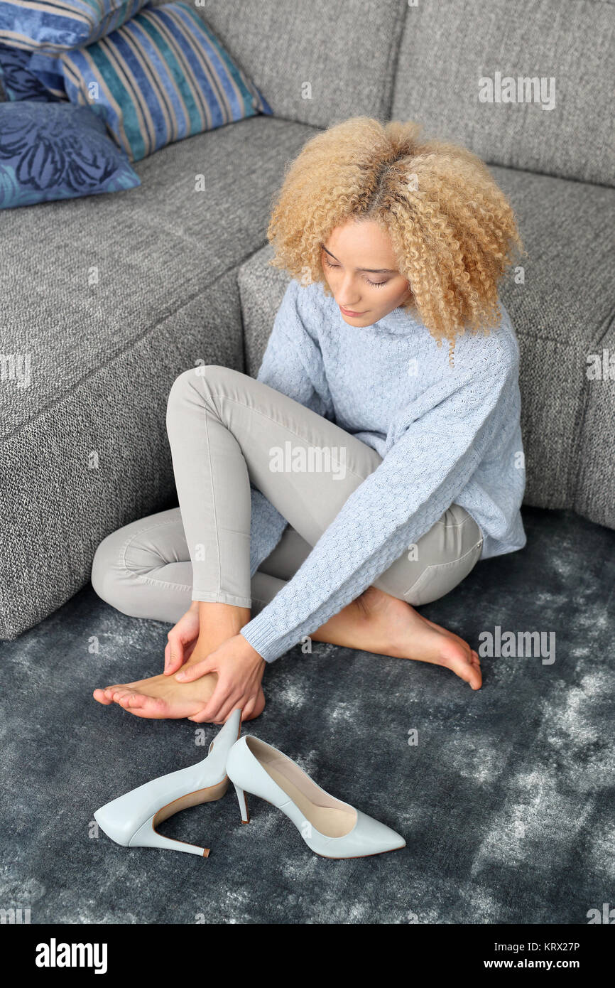 foot massage. aching feet. relax in the comfort of your home. - Stock Image