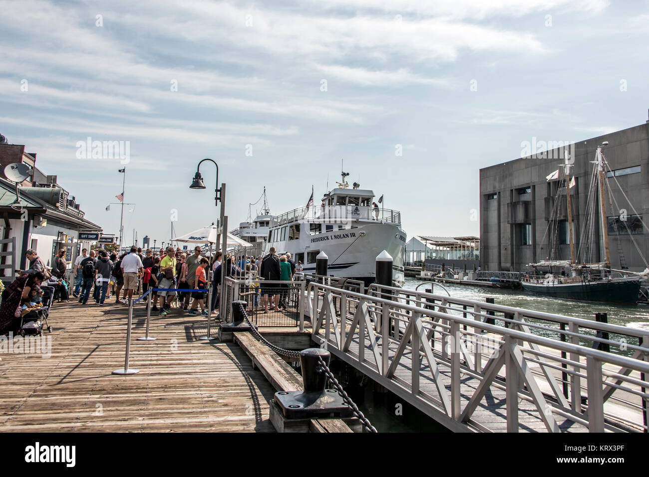 04.09.2017 Boston Massachusetts USA - People everyday life families and boats moored pier long wharf center of Boston - Stock Image