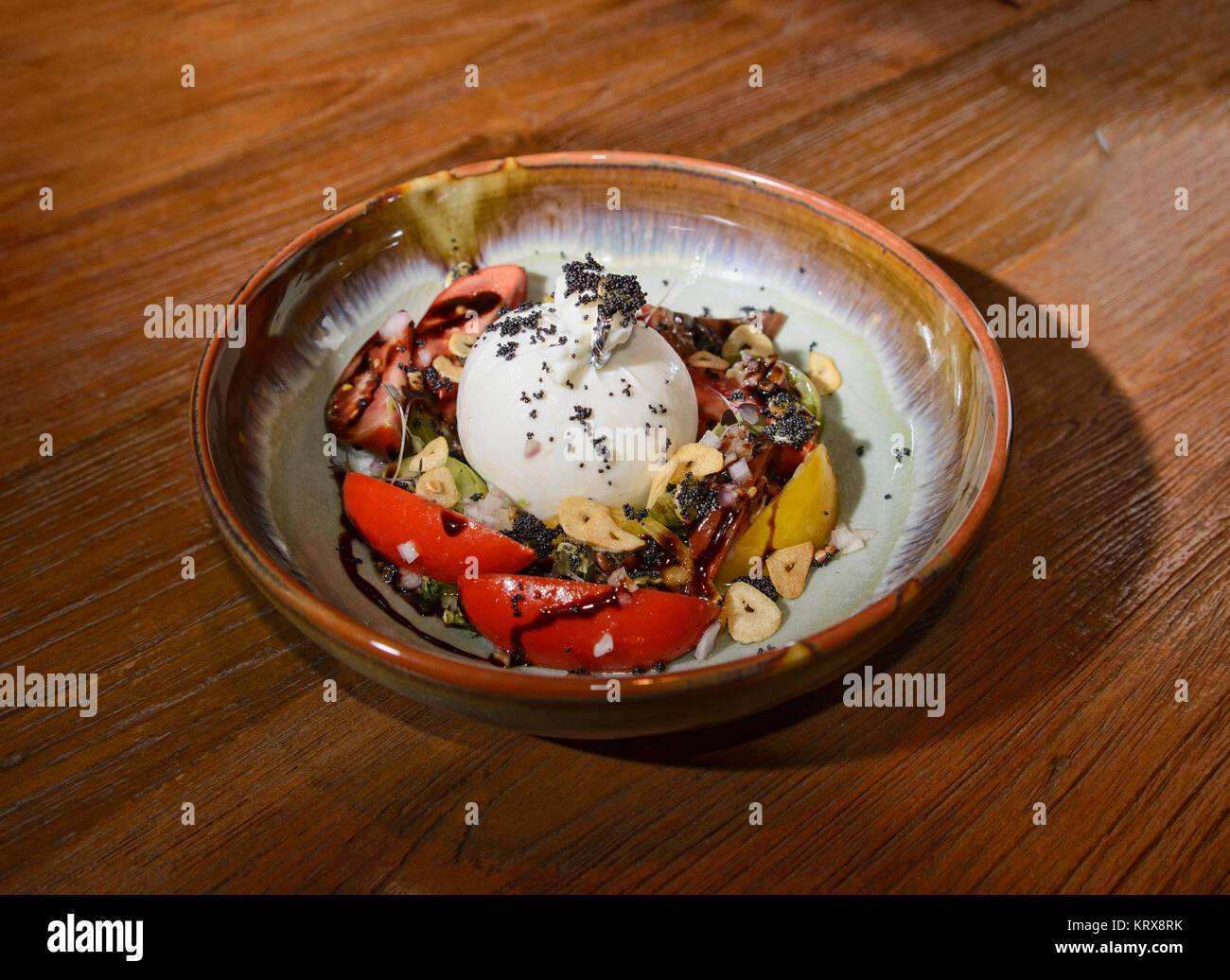 Burrata cheese plate at a restaurant in Bangkok, Thailand
